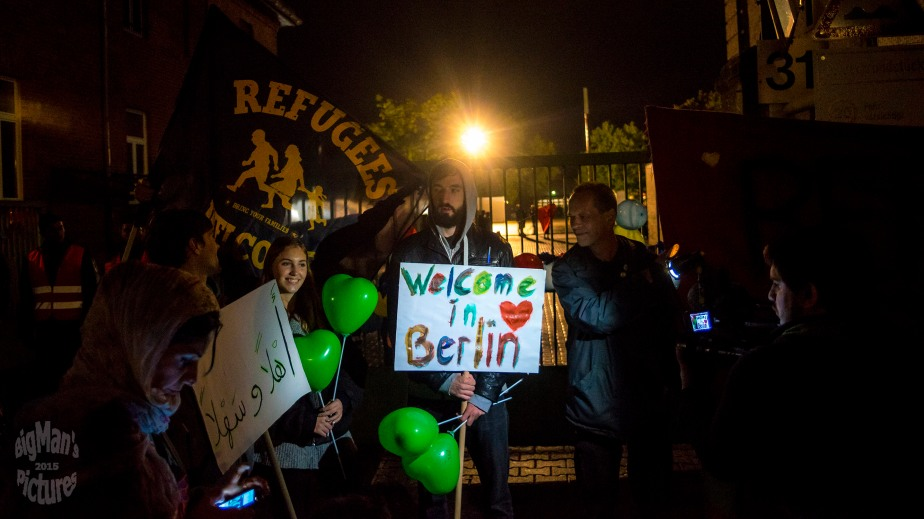 refugees arrive in berlin